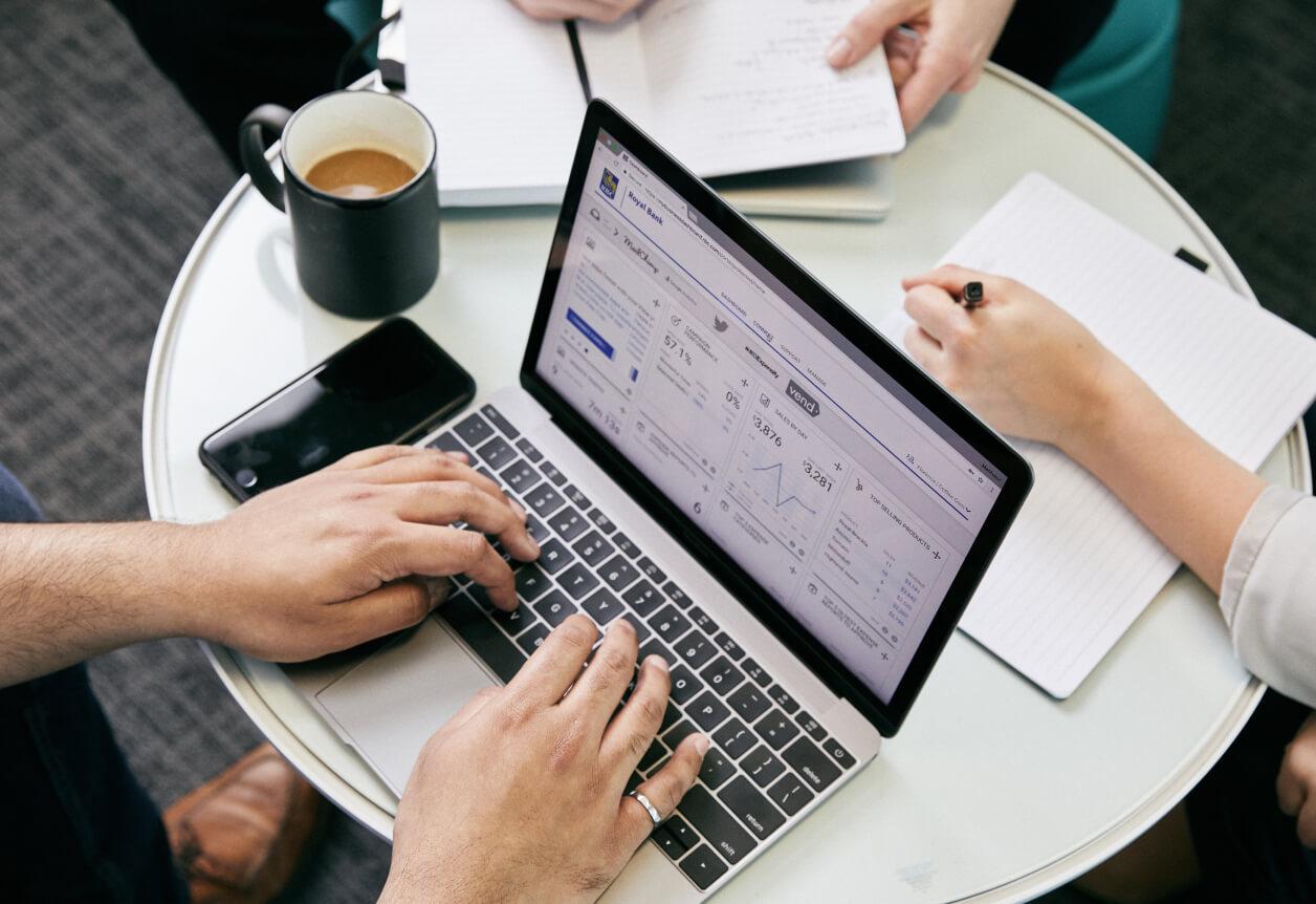 people working around laptop