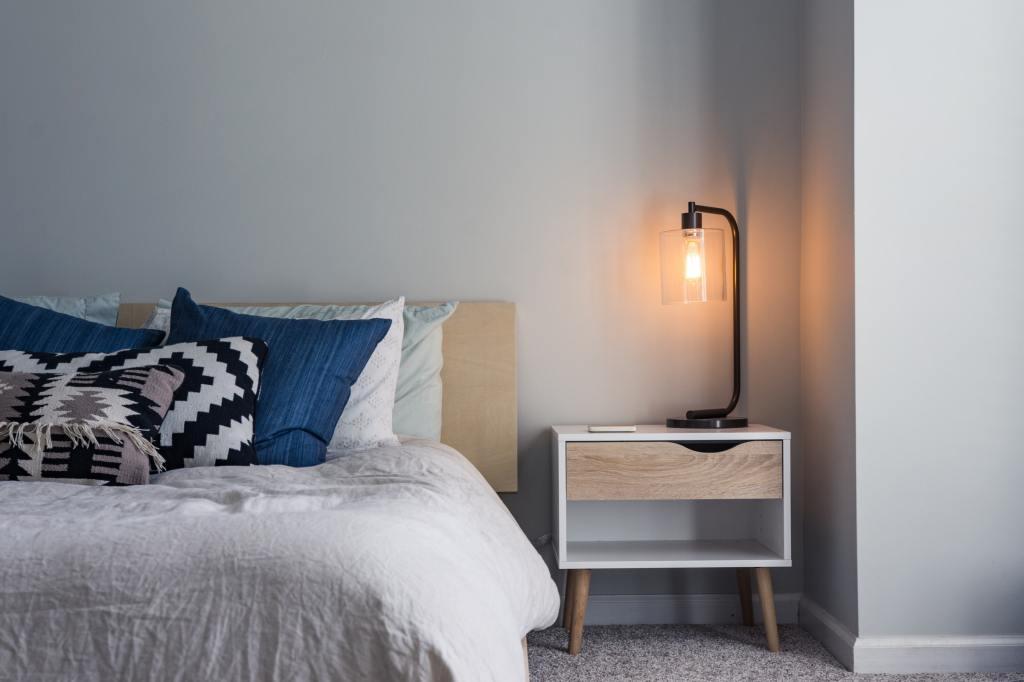 light on bedside table bedroom corner