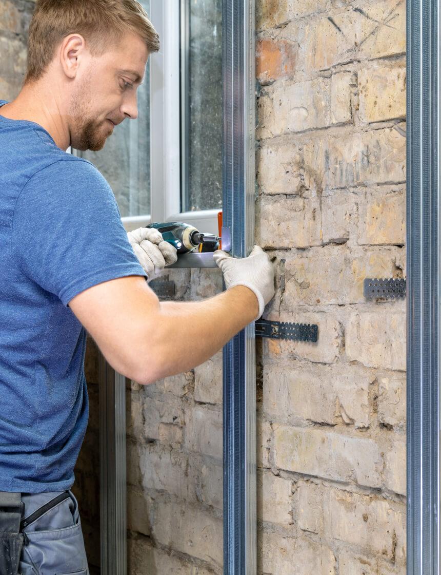 installing framing for exterior siding on house