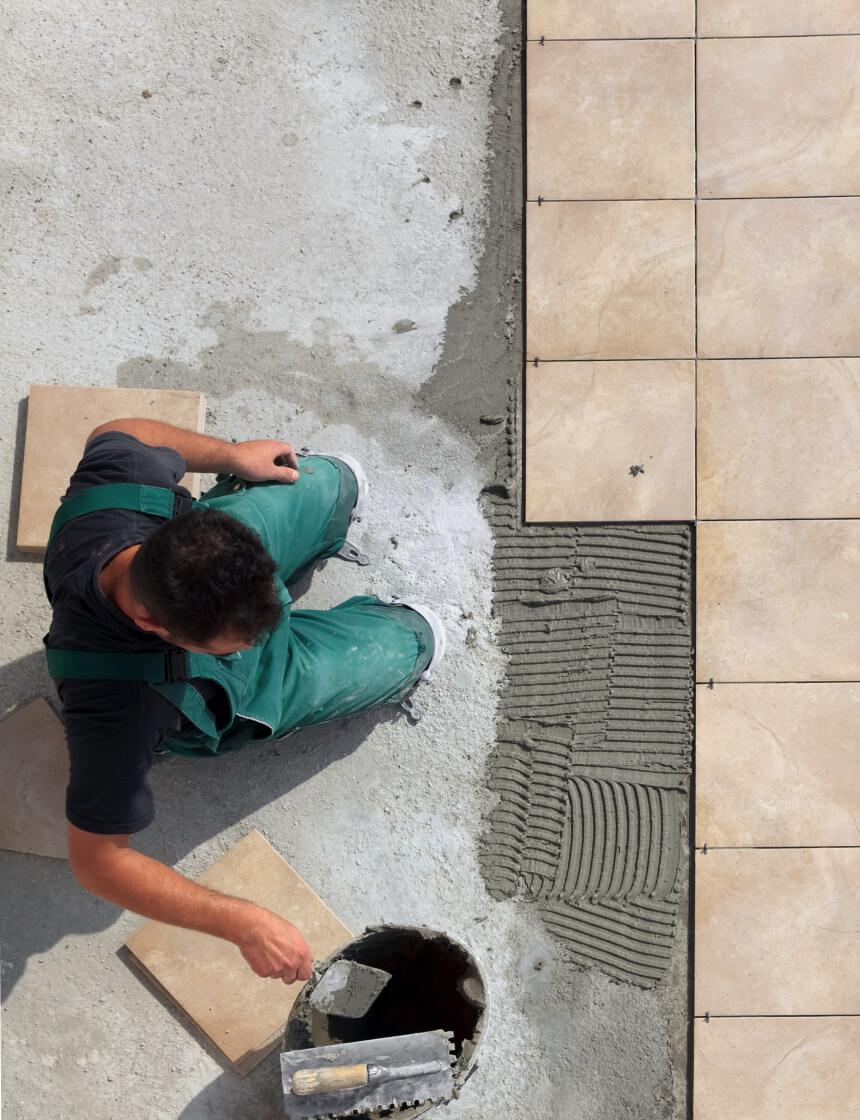 contractor installing ceramic tiles