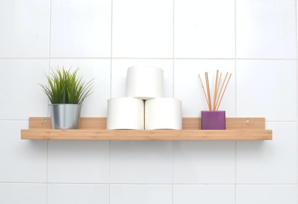 bathroom wood shelf white tiled wall