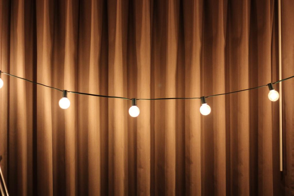 outdoor patio string lights at night against fence